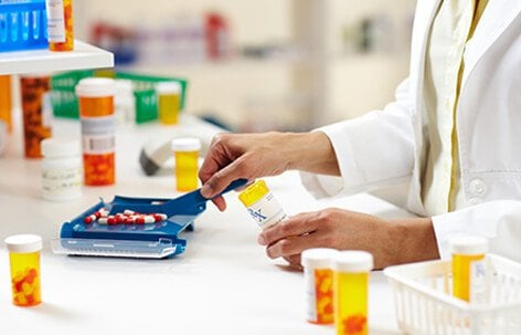 A pharmacist filling prescriptions.
