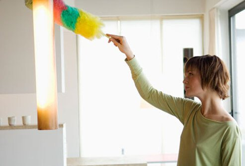 Photo of woman dusting.
