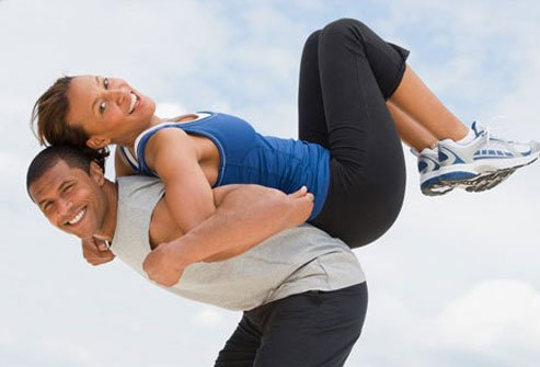 Photo of a couple exercising.