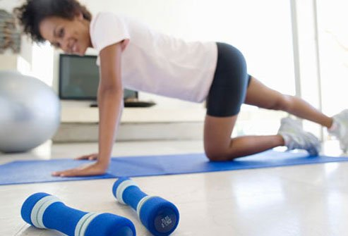 Photo of woman exercising at home.