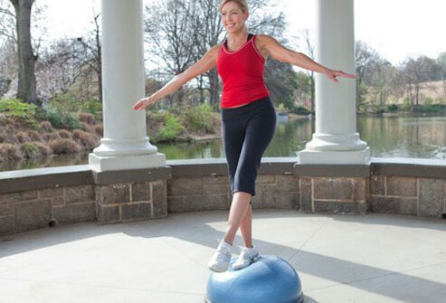 Photo of woman balancing on BOSU.