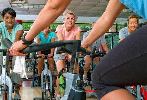 Senior women doing a low-impact spin class.