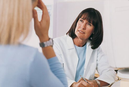 Photo of woman talking to a doctor.