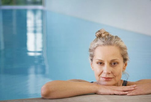 Photo of a woman at the edge of a pool.