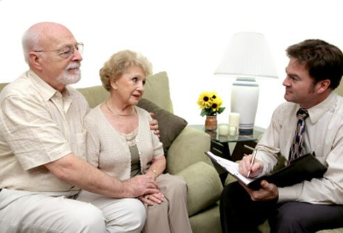A counselor meets with an elderly couple to discuss pancreatic cancer concerns.