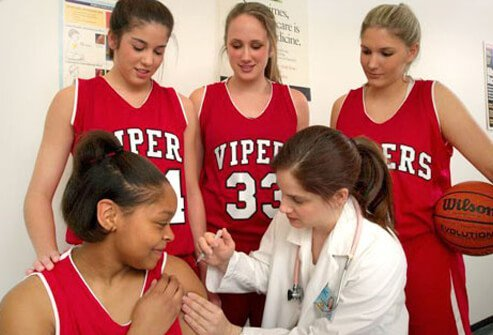 Photo of teens getting vaccinated for whooping cough.