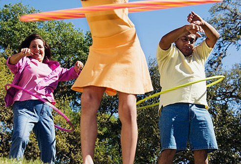 Photo of a family hula hooping together.