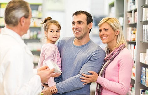 A family discussing treatment options with a pharmacist.