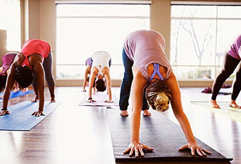 Women active in a yoga class.