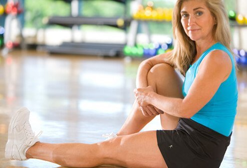 Woman demonstrating thigh exercise.
