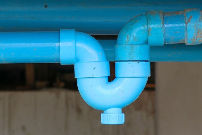 A dried-out P-trap in a drain pipe may lead to a buildup of smelly sewer gas.