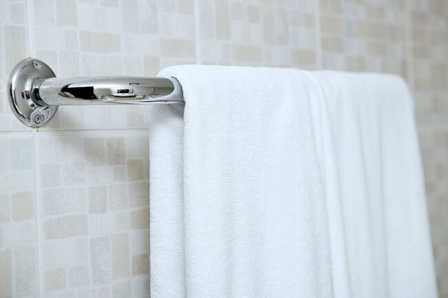 Wash your towels at least once a week to inhibit the growth of bacteria.