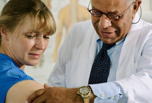 A doctor examines a patient to help confirm a diagnosis of Rocky Mountain spotted fever.