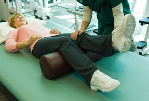Photo of a woman performing physical therapy after sciatica surgery.