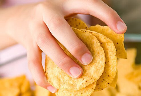 An ounce of chips – six large tortilla chips or about 20 potato chips -- has 2 teaspoons of oil (fat) and 150 calories.