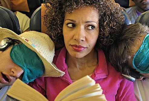 Photo of woman squashed on plane.