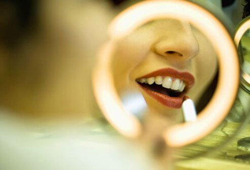 Photo of lipstick lit in mirror.
