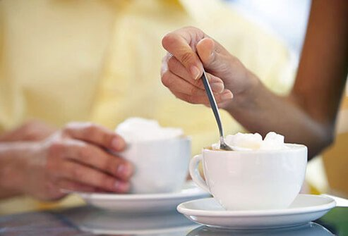 Once you add heavy cream, flavored syrups, or a snowcap of whipped cream, your mug of black coffee is full of fat and sugar.