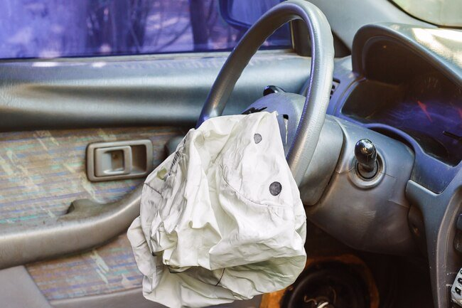 Sodium azide used to trigger air bag deployment may trigger asthma and breathing problems.