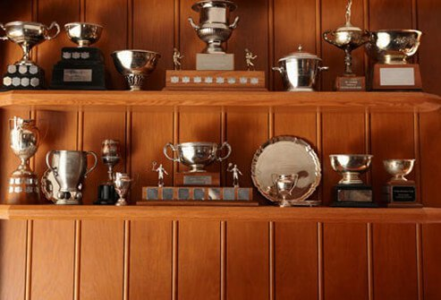 Trophies on a shelf.