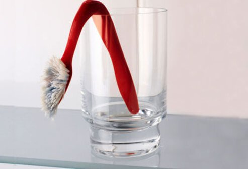 A sagging toothbrush in a glass.