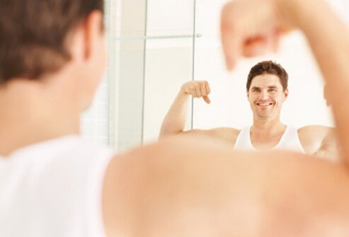 A man is happy with the results of his exercise program.