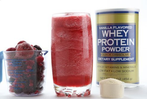 Photo of smoothie with whey protein and frozen berries.