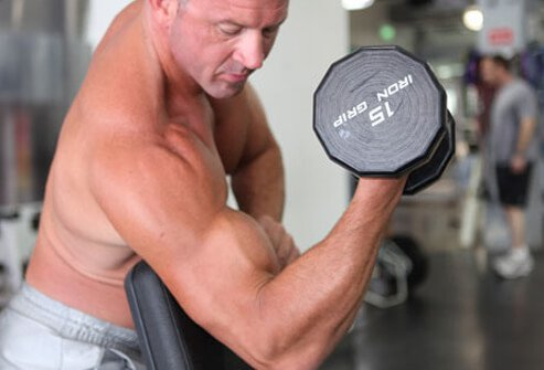 This twist on the curl better isolates the biceps.