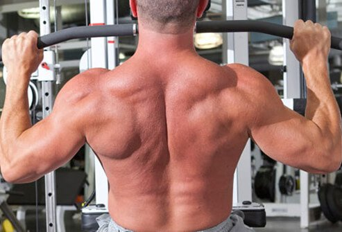 Sit on the pulldown machine and grasp the bar wider than shoulder-width.