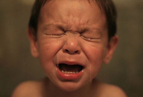 Photo of cranky tired toddler.