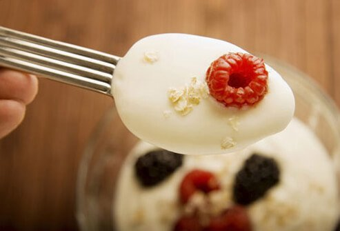 Spoonful of yogurt with berries.