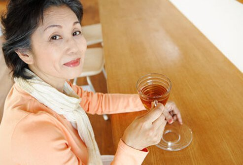 Photo of mature woman drinking tea.