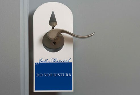 Do not disturb sign hangs on a hotel room door.