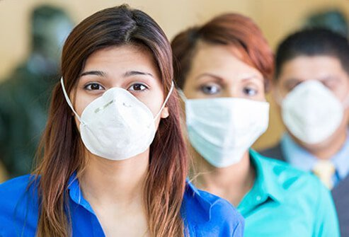 Employees wearing surgical masks in hopes of avoiding those that are contagious.
