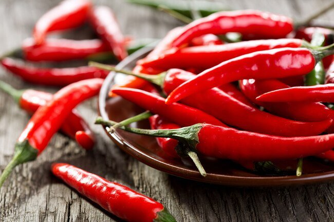 Capsaicin blocks inflammation when you take it internally, but it is also found in topical creams.