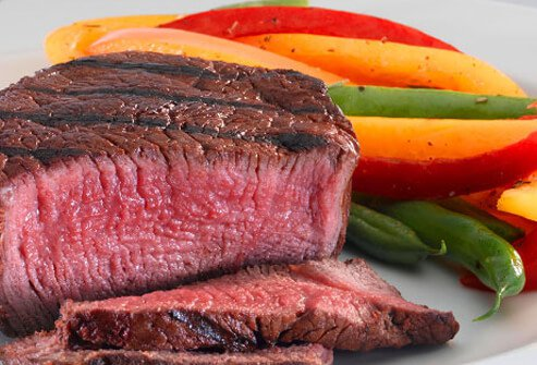 Steak and steamed vegetables.