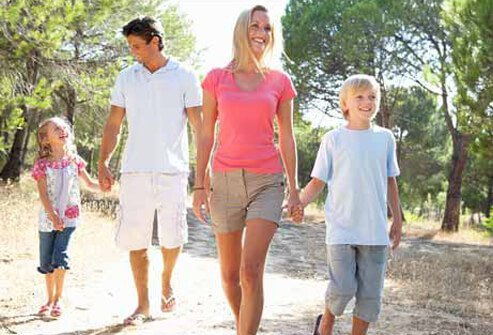 A family goes on a nature walk through the park.