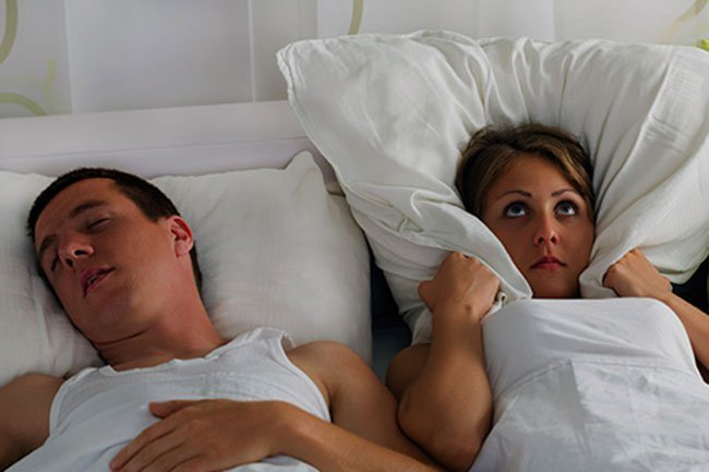 Snoring is loud enough to wake your partner.